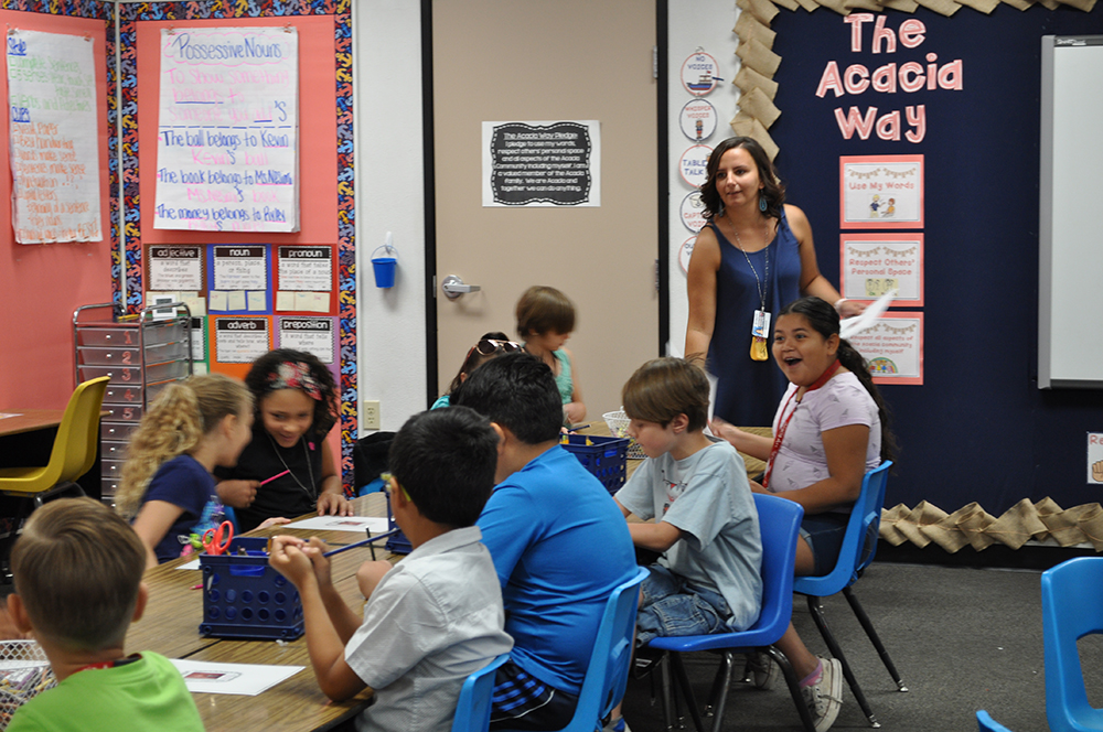 Second Grade Teacher Diana Nesimi's Class Works On An Assignment Where They Add Positive Comments To Pages With Classmates Photos On Them At Acacia Elementary School On May 21, 2018. Photo By Lisa Irish/AZEdNews