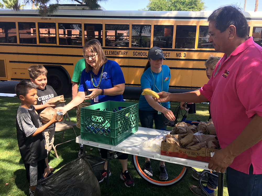 Nutrition Services Administrative Assistant Andrea Heaton Alongside Coworkers Jessica Braboy And Gilbert Urias Serves Lunch To Two Boys At A Mobile Lunch Bus Stop During The Recent Walk-out. Photo Courtesy Tempe Elementary School District