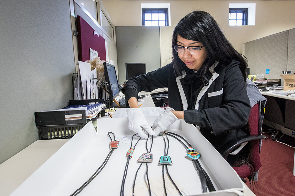 """I'm Kind Of On A Roll With Cataloging,"" Noted ASU Alumna And Mellon Fellow Kayannon George, As She Neared Completion Of Cataloging The Norman L. Sandfield Collection Of Bolo Ties. Photo By Charlie Leight/ASU Now"