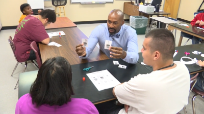 Meet the students who say remote learning works just fine Kareem-Neal-with-Students-1-400x225