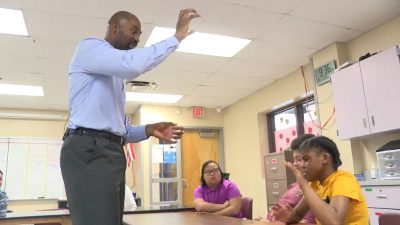 Controversial Virtual School Operator Pivots to Job Training Kareem-Neal-with-Students-400x225