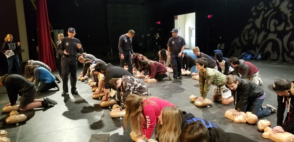 More Than 2,000 Queen Creek High School Students Practiced Hands-only CPR Under The Guidance Of Firefighters From The Queen Creek Fire And Medical Department. Photo Courtesy Queen Creek Unified School District
