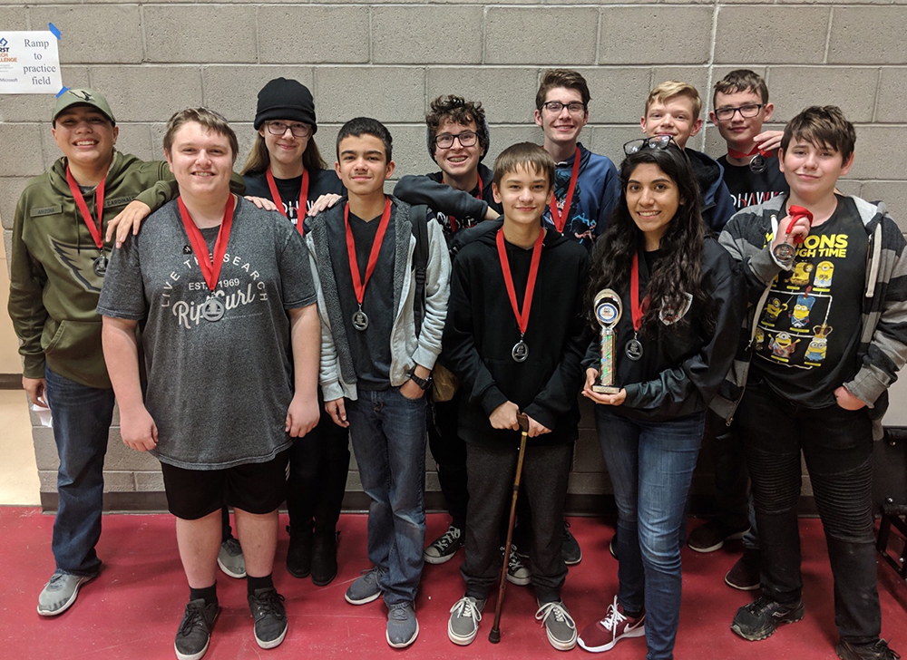 Williams Field High School's RoboHawks Celebrate Their Many Awards After A FIRST Tech Challenge Robotics Competition In Tucson In December. Photo Courtesy Higley Unified School District