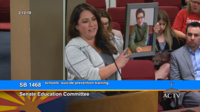 At House Education Hearing, Lawmakers Differ Sharply on Why Teachers Are Underpaid Sheila-Headstrom-Pelger-and-photo-of-her-son-Tyler-who-took-his-life-1-400x225