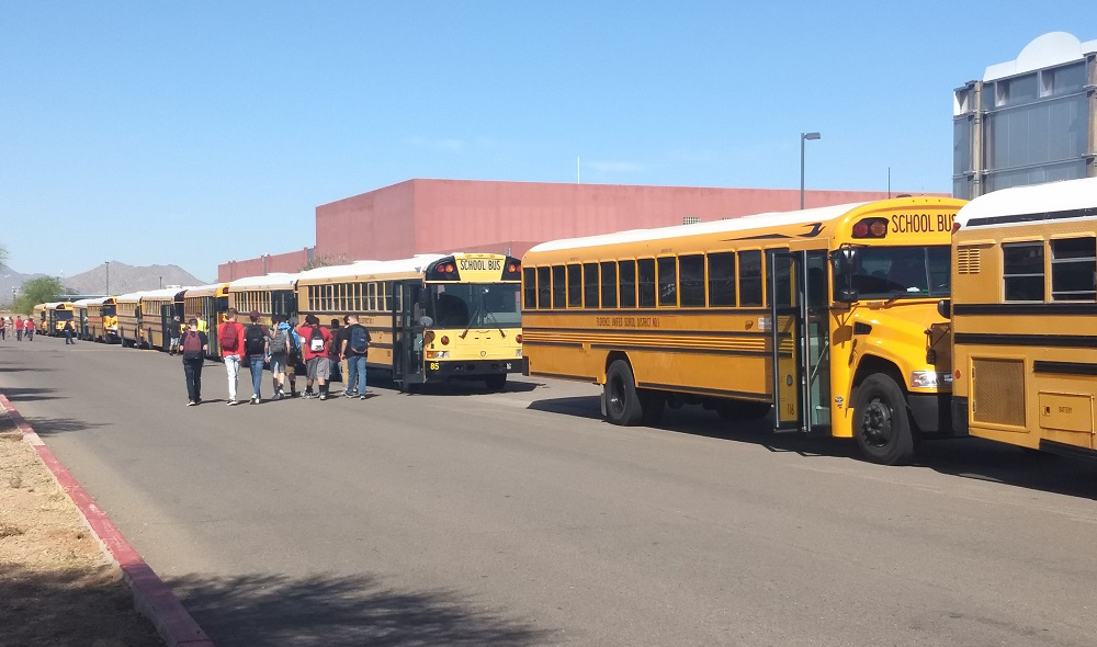 Florence Unified School District Students Walk Near Buses. Photo Courtesy Florence Unified School District