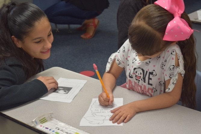 Arizona students celebrate the life and work of César Chávez CW-Harris-7th-and-1st-grader-work-on-project-2