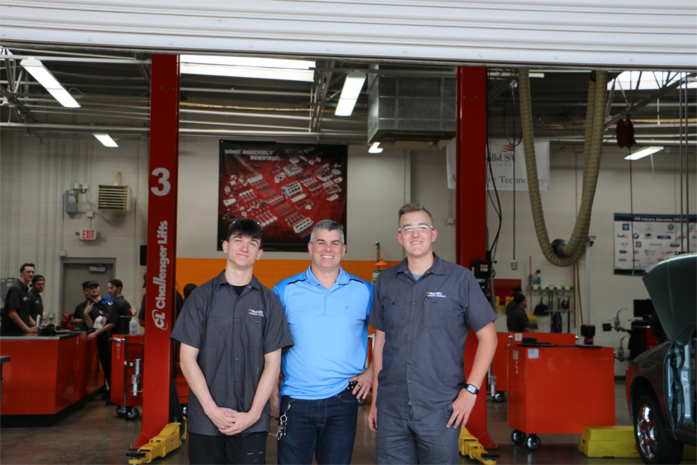 Kyle Holloway (left), Nick Shumaker (center), And Landon Holloway (right) In The Automotive Lab At West-MEC's Northeast Campus In Deer Valley. Photo Courtesy Of West-MEC