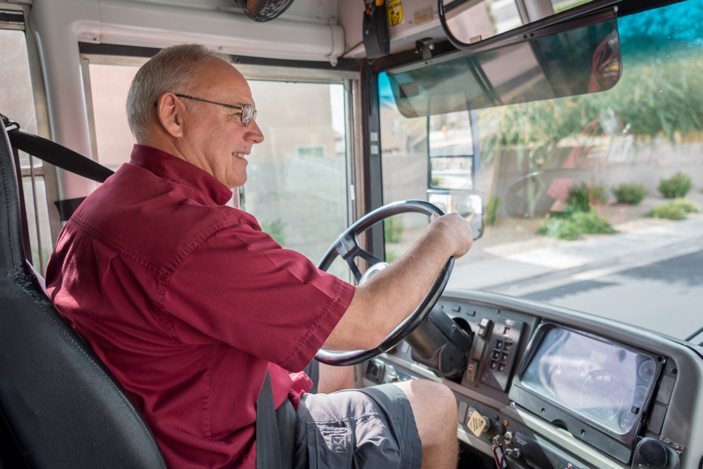 Paul Greer, A Bus Driver For Dysart Unified School District, On His Bus. Photo Courtesy Dysart Unified School District.