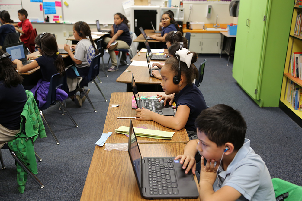 Perlata Elementary Students Work On Computers During Class. Photo By Brooke Razo/ASBA