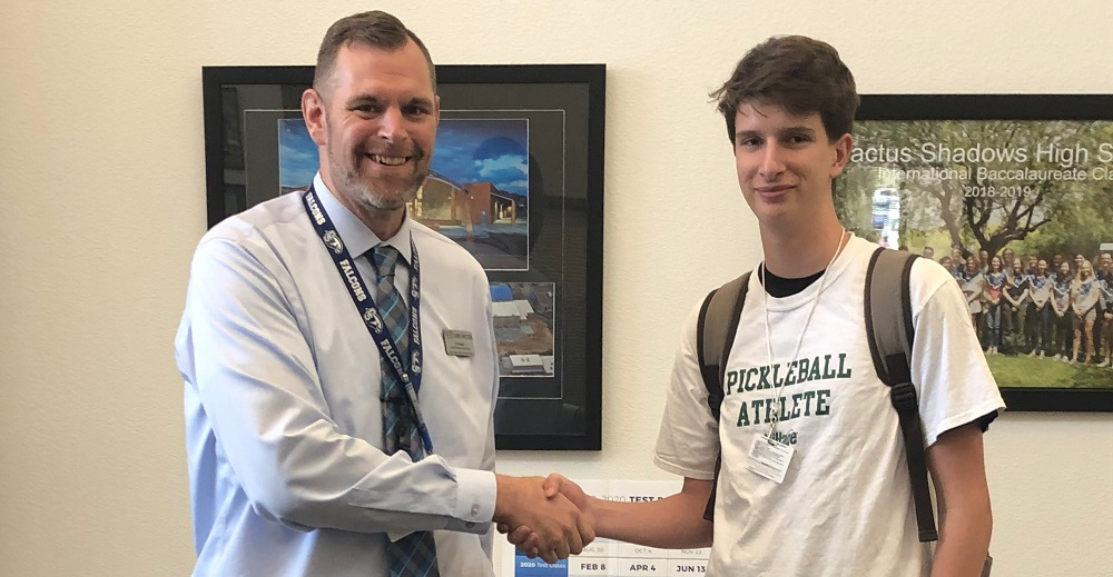 Cactus Shadows High School Principal Jim Swetter Congratulates Colin McConnon, Who Was Recently Named A National Merit Scholarship Semifinalist By The National Merit Scholarship Corporation. Photo Courtesy Cave Creek Unified School District