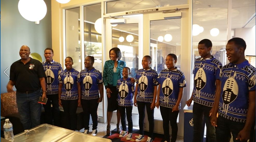 ASBA's Executive Director Dr. Sheila Harrison-Williams With The Bulembu Choir, A Group Of Students From A Small Town In Africa, Who Performed At A Reception For Her At ADM Group Inc. In Tempe. Photo By Brooke Martinez/ ASBA