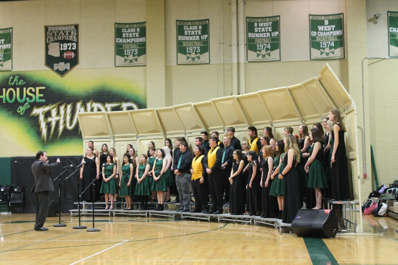 MHS Choir Director Cameron Pruett (l) Leads Students In A Performance During Last Year's Veterans' Day Assembly. Photo Courtesy Colorado River Union High School District