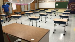 Districts go round and round on school bus reopening plans Empty-classroom-310x175