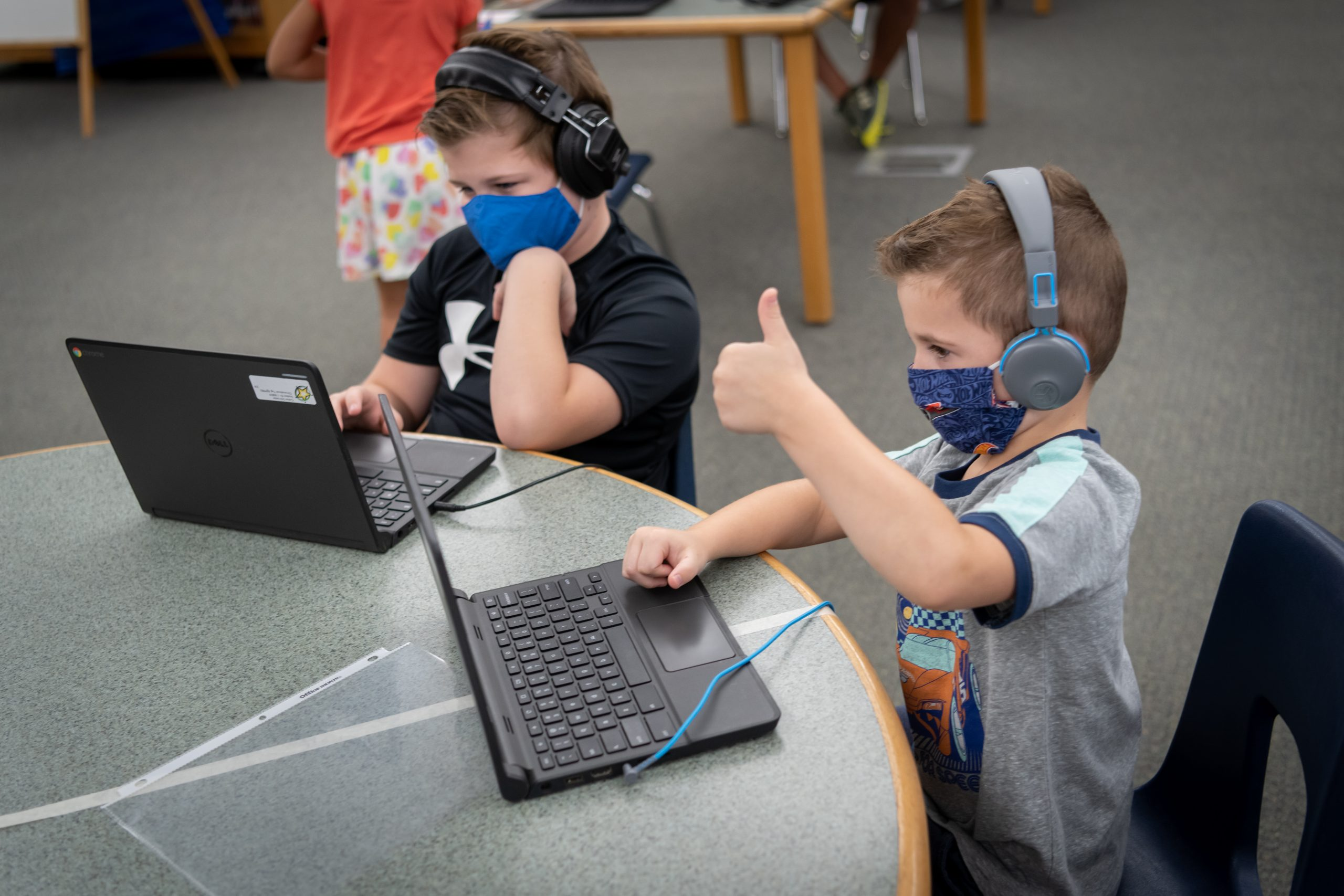 Marley Park Elementary School Students Conner Schroeder, Kindergarten And Colton Schroeder, 5th Grade, Participate In Remote Learning Through An In-person Learning Lab. Photo Courtesy Of Dysart Unified School District