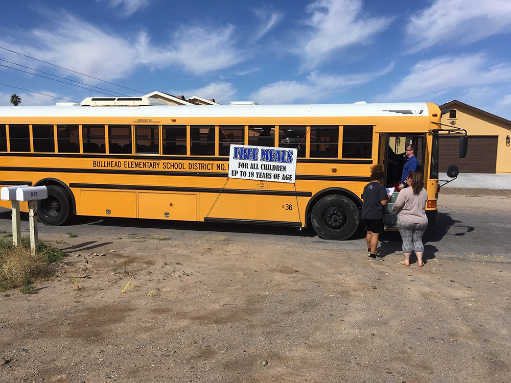 A Family Picks Up Meals For Students From Bullhead City Elementary School District At A Bus Stop Near Their Home. Photo Courtesy Bullhead City Elementary School District
