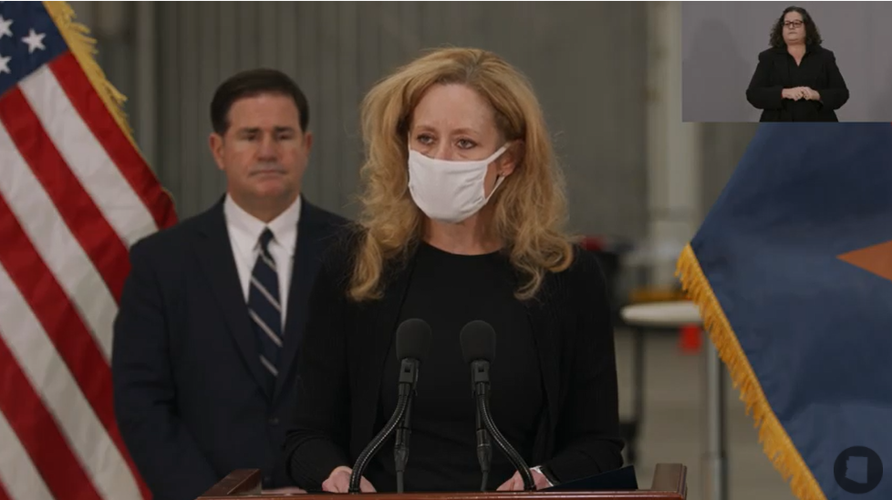 Arizona Dept. Of Health Services Dr. Cara Christ Speaks As Gov. Doug Ducey Looks On At A News Conference On Dec. 16, 2020. Photo Courtesy Office Of The Arizona Governor