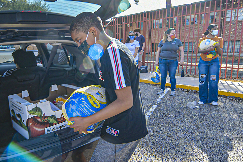 A Volunteer Loads Up Meals Provided By Tucson High Magnet School Graduate Levi Wallace To District Families. Photo Courtesy Of Tucson Unified School District