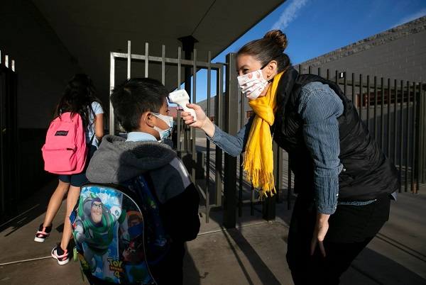 Creighton School District Staff Takes A Student's Temperature As They Arrive On Campus For In-person Learning. Photo Courtesy Creighton School District