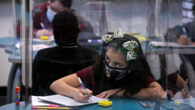 Biden budget seeks more for schools, health care and housing Creighton-Student-in-class-with-mask-and-screen-900-400x225