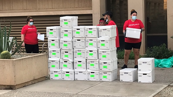 Advocates turn in signatures to put tax cuts that impact education funding on ballot Boxes-of-signed-petitions-cropped-600