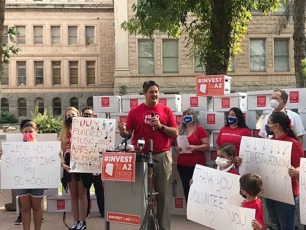 Advocates turn in signatures to put tax cuts that impact education funding on ballot Joe-Thomas-at-Invest-in-AZ-Coalition-press-conference-600